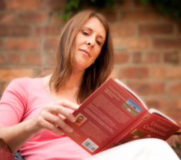 Person reading the book, Universal Compassion